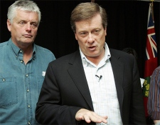 Ontario Progressive Conservative leader John Tory, right, with candidate Toby Barrett, MPP for Haldimand-Norfolk-Brant speaks in Caledonia, Ontario on Sunday, Sept. 23, 2007. (CP / Dave Chidley)