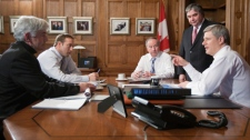 Prime Minister Stephen Harper receives a national security briefing from Public Safety Minister Peter Van Loan, Foreign Affairs Minister Lawrence Cannon, National Defence Minister Peter MacKay, Minister of Justice and Attorney General of Canada Rob Nicholson in this undated photo. (Deb Ransom / PMO)
