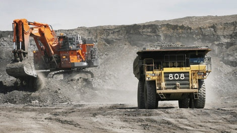A haul truck carryong a full load drives away from a mining shovel at the Shell Albian Sands oilsands mine near Fort McMurray, Alta., Wednesday, July 9, 2008. (THE CANADIAN PRESS/Jeff McIntosh)