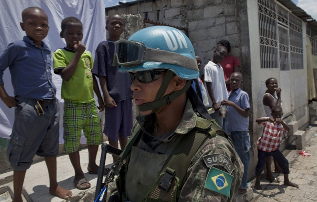 A Brazilian UN peacekeeper patrols during Senate elections in Cite Soleil in Port-au-Prince, Sunday, April 19, 2009. The UN said their headquarters in the country had been destroyed in the earthquake. Brazil has a large number of peackeeping troops in the country. (AP / Ramon Espinosa)