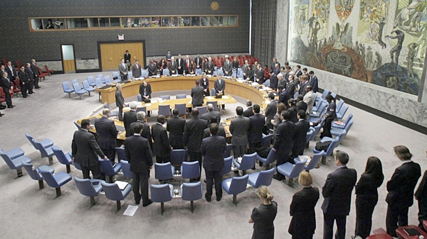 The United Nations Security Council stands for a moment of silence, Wednesday, Jan. 13, 2010. (AP / Richard Drew)