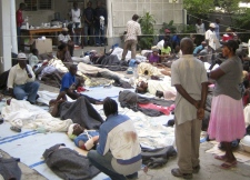 This photo provided by Medecins Sans Frontieres (Doctors Without Borders) shows wounded people gathered at the office of Medecins Sans Frontieres in Port-au-Prince, Haiti, Wednesday, Jan. 13, 2010.