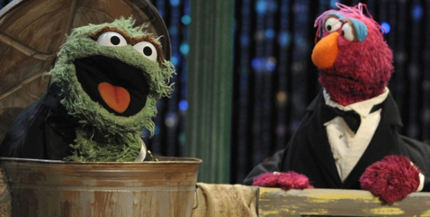 Oscar the Grouch, left, and Telly Monster, of the children's television show Sesame Street, perform at the Daytime Emmy Awards on Sunday Aug. 30, 2009, in Los Angeles. (AP / Chris Pizzello)