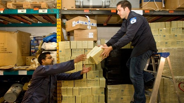 GlobalMedic volunteer Sean D'Souza, left, and Emergency Program manager Matt Capobianco prepare boxes of supplies destined for Haiti, at their Toronto headquarters, on Wednesday, Jan. 13, 2010. (Darren Calabrese / THE CANADIAN PRESS)