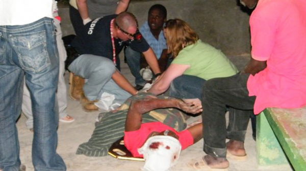 Victims are seen being taken care of at a clinic set up by the Mission of Hope, about 45 minutes northeast of Port au Prince, Haiti. (Sandy Rumford for CTV.ca)