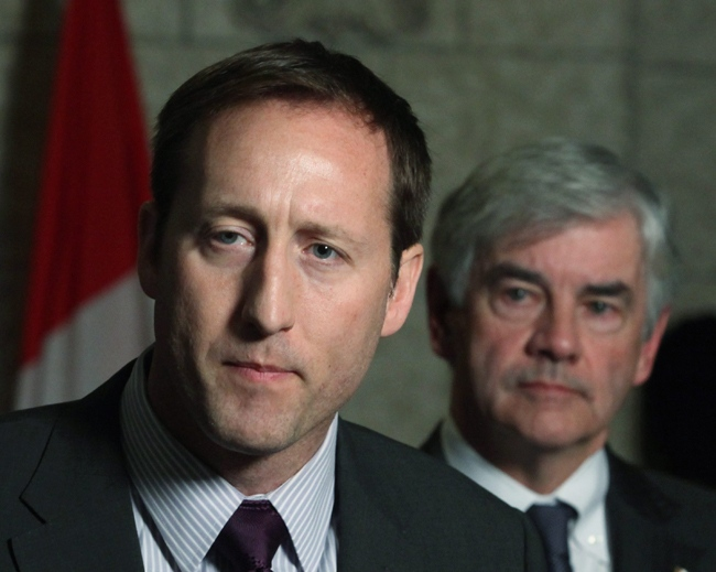 Defence Minister Peter MacKay (left) and Foreign Affairs Minister Lawrence Cannon hold a news conference to announce Canada's aid to the disaster in Haiti in Ottawa on Wednesday, Jan. 13, 2010. (Fred Chartrand / THE CANADIAN PRESS)