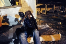 Gunsly Milsoit, left, comforts his brother-in-law Leo Pierre after Leo's wife and Gunsly's sister, Milsoit Kelly, who was three months pregnant, died when a building collapsed in Port-au-Prince, Haiti, Wednesday, Jan. 13, 2010. (AP / Gerald Herbert)
