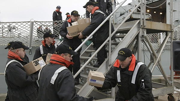 Military personal from HMCS Halifax take on supplies shortly before the ship leaves port in Halifax, N.S., Thursday, January 14, 2010. (Mike Dembeck / THE CANADIAN PRESS)