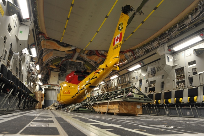 A CH-146 Griffin helicopter is secured onboard a CC-177 Globemaster at CFB Trenton for a DART humanitarian mission to Haiti, late Wednesday, Jan. 13, 2010. DART departed for Haiti early Thursday, Jan. 14, 2010. (Warrant Officer Carole Morissette / Department of National Defence)