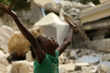 Cindy Terasme screams after seeing the feet of her dead 14-year-old brother Jean Gaelle Dersmorne in the rubble of the collapsed St. Gerard School in Port-au-Prince, Haiti, Thursday, Jan. 14, 2010. (AP / Gerald Herbert)