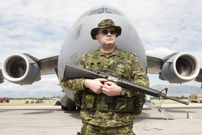 Master Cpl. Mike Lehman guards the Canadian Forces CC-177 Globemaster on its arrival in Port-au-Prince, Haiti Thursday, Jan. 14, 2010. (Adrian Wyld / THE CANADIAN PRESS)
