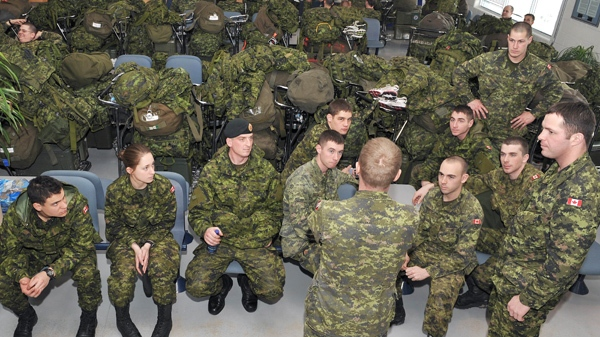 Disaster Assistance Response Team (DART) members wait for word of their flight to Port-au-Prince Haiti CFB Trenton's passenger terminal, 15 January 2010. (Corporal Shilo Adamson / Department of National Defence)