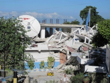 In this Wednesday, Jan. 13, 2010 photo released by the Philippine Mission to the United Nations, police officers from the United Nations inspect what was left of the United Nations Police Headquarters in Port-au-Prince.