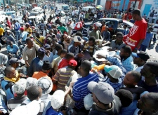 People gather around a gas pump seeking gas, Thursday, Jan. 14, 2010, in Port-au-Prince, Haiti. Gas shortage is causing long lines and angry customers. (AP / The Miami Herald, Carl Juste)