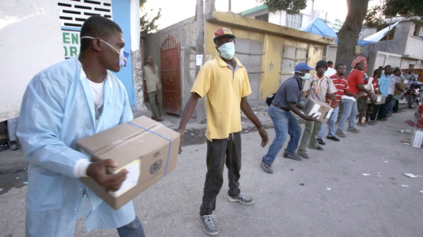 A medical worker unloads medical supplies from a truck at a hospital on the outskirts of Port-au- Prince, Haiti, Friday, Jan. 15, 2010. (AP / Julie Jacobson)
