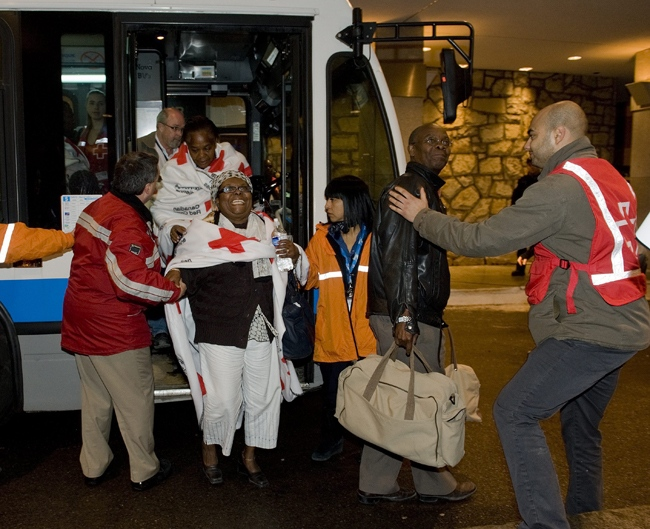 The first group of Canadians caught in Haiti's earthquake arrive in Montreal early Friday morning Jan. 15, 2010. (Peter McCabe / THE CANADIAN PRESS)
