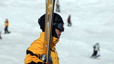 A skier, wearing a helmet, leaves the slopes at Mont Tremblant after a day of skiing on March 19, 2009. THE CANADIAN PRESS/ Peter McCabe