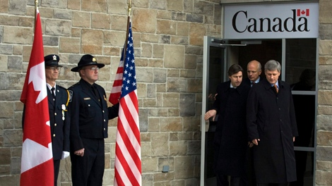 Veterans Affairs Minister Greg Thompson, centre, is seen with Prime Minister Stephen Harper, right, and N.B. Premier Shawn Graham, left, at the opening of a new Canada-U.S.A. border crossing to Calais, Maine, in St. Stephen, N.B. on Friday, Jan. 8, 2010. (Andrew Vaughan / THE CANADIAN PRESS)