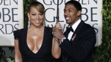 Mariah Carey and Nick Cannon arrive at the 67th Annual Golden Globe Awards on Sunday, Jan. 17, 2010, in Beverly Hills, Calif. (AP / Matt Sayles)