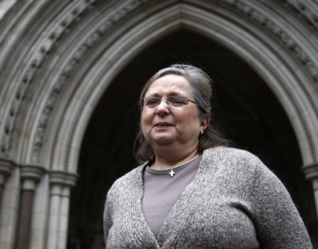 Christian British Airways check-in employee Nadia Eweida arrives at the Royal Courts of Justice to fight a ruling that she was not a victim of religious discrimination by British Airways, London, Tuesday, Jan. 19, 2010. (AP Photo/Sang Tan)