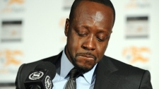 Haitian-born musician Wyclef Jean is overcome with emotion while discussing his recent visit to earthquake-stricken Haiti and how is organization, Yele Haiti, is helping with relief efforts, Monday, Jan. 18, 2010, in New York. (AP / Diane Bondareff)