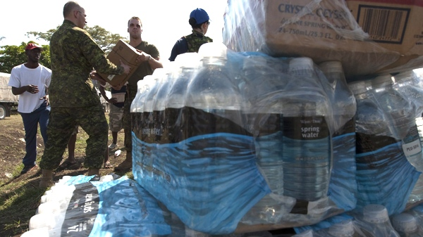 Canadian soldiers provide assistance moving humanitarian aid at the airport in Jacmel, Haiti, on Wednesday, Jan. 20, 2010. (Adrian Wyld / THE CANADIAN PRESS)
