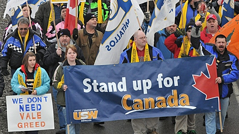 Striking members of the United Steelworkers local 6500 and supporters march in Sudbury,Ontario on Wednesday, Jan. 13, 2010, to mark the sixth month of their strike against Vale Inco.(THE CANADIAN PRESS/Gino Donato)