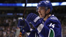 Vancouver Canucks' Alex Burrows celebrates his goal against the Phoenix Coyotes during first period NHL action in Vancouver, B.C., on Thursday January 7, 2010. THE CANADIAN PRESS/Darryl Dyck