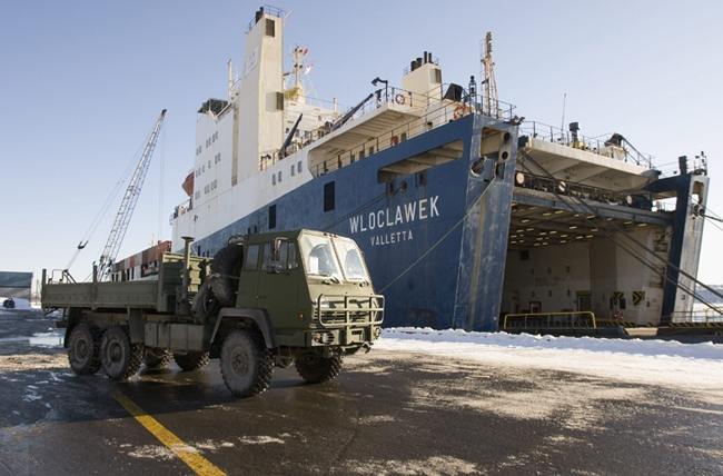 A Canadian Forces truck prepares to be loaded on the MV Wloclawek at the Quebec City port, Thursday, Jan 21, 2010. Military vehicles, including water purifying units and bulldozers, are being shipped to Haiti for a humanitarian mission. (Jacques Boissinot / THE CANADIAN PRESS)