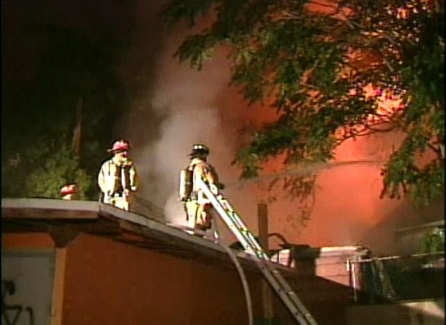 Firefighters battle the blaze on Fitzroy Terrace near Kensington and Dundas.