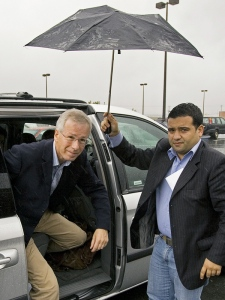 Liberal Leader Stephane Dion is assisted by a staff member as he arrives at a coffee shop to meet supporters in Halifax on Friday, Sept. 28, 2007. (THE CANADIAN PRESS / Andrew Vaughan)