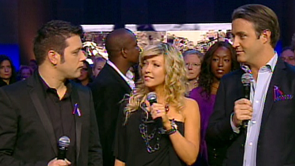From right to left, CBC's George Stroumboulopoulos, Global's Cheryl Hickey and CTV's Ben Mulroney host a telethon for Haiti, Friday, Jan. 22, 2010.