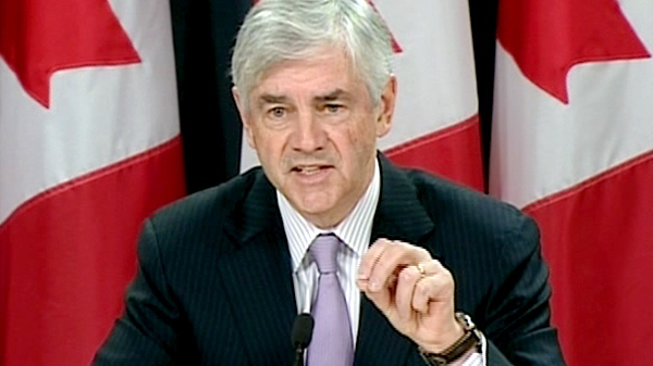 Foreign Affairs Minister Lawrence Cannon speaks to the media in Ottawa, on Sunday, Jan. 24, 2010.