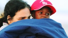 A Haitian orphan arrives at the Ottawa airport, on Sunday, Jan. 24, 2010. (Fred Chartrand / THE CANADIAN PRESS)
