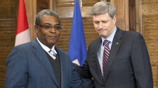 Haitian Prime MinisterJean-Max Bellerive (left) meets with Canadian Prime Minister Stephen Harper on Parliament Hill in Ottawa on Sunday, Jan. 24, 2010. (Pawel Dwulit / THE CANADIAN PRESS)
