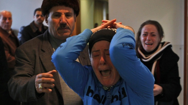 Relatives of passengers of the Ethiopian Airlines plane react upon their arrival at Beirut airport, Lebanon, Monday, Jan. 25, 2010. (AP / Hussein Malla)