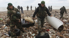 Lebanese soldiers gather debris from the Ethiopian Airlines plane that crashed in the sea on the shore near Beirut airport, Lebanon, Monday, Jan. 25, 2010. (AP / Hussein Malla)