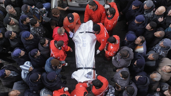 Lebanese Red Cross workers carry the body of one of the victims of the Ethiopian Boeing 737-800 plane that crashed in the sea, into the Rafik Hariri Hospital in Beirut, Lebanon, Monday, Jan. 25, 2010. (AP / Ben Curtis)