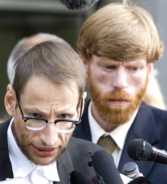 James Plater looks on as James Kreppner (left) with the Canadian Hemophilia Society speak to the media outside the courthouse following the verdict in the tainted blood in Toronto on Oct. 1, 2007. (CP / Adrian Wyld