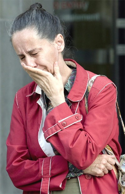 Noella Baker holds back her emotions after the verdict in the tainted blood case was handed down in Toronto on Oct. 1, 2007. (CP / Adrian Wyld)