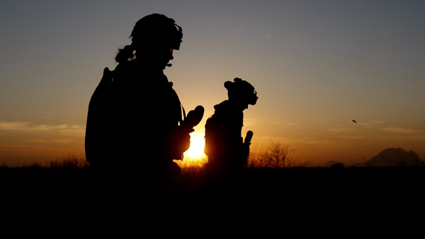 Canadian soldiers from Task Force 3-09 Battle Group are seen in silhouette as they patrol at the start of operation Tazi, a village search and securing operation in the Dand area of Kandahar Province, southern Afghanistan Monday, Jan. 25, 2010. (AP / Kirsty Wigglesworth)