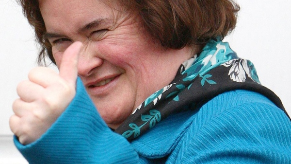 Singer Susan Boyle Gives A Thumbs Up Sign Outside Her House In Blackburn Scotland