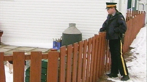 An RCMP officer is seen in Harbour Mille, N.L. were there were several reports of a mysterious object in the sky.