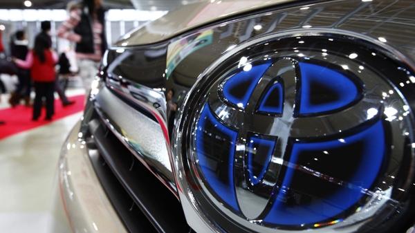 Visitors walk by a car at a Toyota showroom in Tokyo, Japan, Thursday, Jan. 28, 2010. (AP / Shizuo Kambayashi)