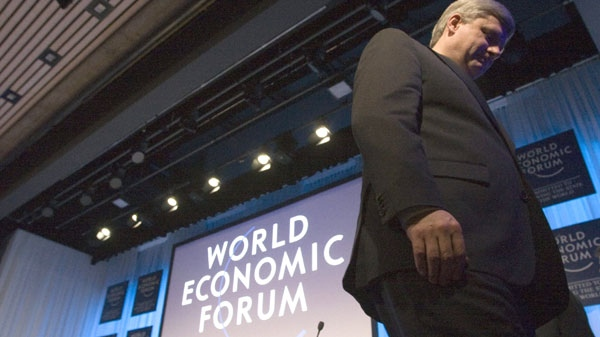 Prime Minister Stephen Harper leaves the stage after speaking at the World Economic Forum in Davos, Switzerland on Thursday January 28, 2010. (Frank Gunn / THE CANADIAN PRESS)