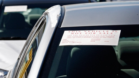 Dozens of Toyota Camrys, Corollas and other models that have been withdrawn for sale identified by stickers on the windshield, or by a single windshield wiper pointing skyward, or both are seen at a storage lot for Keyes Toyota in the Van Nuys area of Los Angeles, Thursday, Jan. 28, 2010. (AP / Reed Saxon)