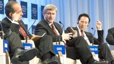 Mexican President Felipe Calder�n (left) and South Korean President Lee Myung-Bak (right) listen as Canadian Prime Minister Stephen Harper speaks at the World Economic Forum in Davos, Switzerland on Thursday January 28, 2010. (Frank Gunn / THE CANADIAN PRESS)