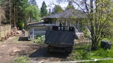 A Google Street View car caught a total of 23 trees being cut down on a southwest Vancouver property. But the homeowner only had a permit to cut down two trees. (Google Street View)