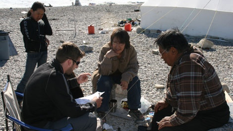 Dr. James Ford talks to local residents of Igloolik about how changing ice conditions are affecting their ability to hunt and fish in this undated 2007 photo by Graham McDowell. (Courtesy of James Ford)
