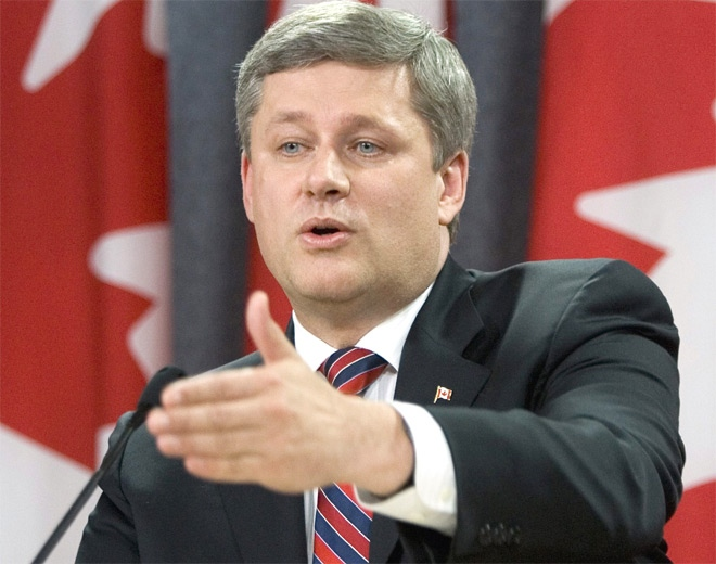Prime Minister Stephen Harper answers reporters questions for his first press conference at the National Press Theatre in Ottawa on Oct. 3, 2007. (CP /Tom Hanson)